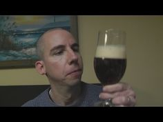 Intentional ASMR video of a guy doing a show and tell of a beer and a rubix cube.