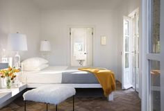 good color combo - gray, white, and yellow! (croatian bedroom by steven harris architects via remodelista)