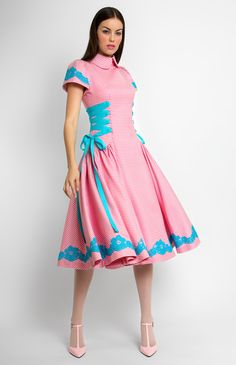 Fine wool dress trimmed with lace and ribbon. Turndown collar with a collar stand. Decorative side ribbon lacing. Hidden back zip closure. Without pockets.
