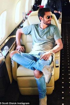 Scott Disick wearing Common Projects Suede Chelsea Boots, John Elliott Round Neck T-Shirt, Fear of God Selvedge Denim Vintage Indigo Jeans and Ray-Ban Original Aviators