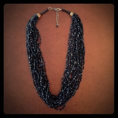 """Black Beaded Necklace Black & silver beaded necklace. Has multiple strands of beads. Measures 10"""" in length. Clasp closure. Jewelry Necklaces"""