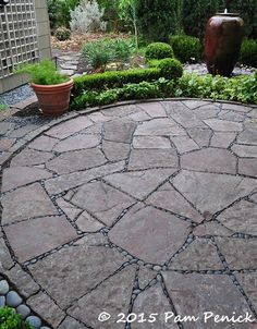 "Flagstone ""mortarted"" with MX beach pebbles."