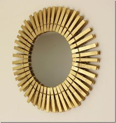 Sun burst mirror made with clothes pins. I can just see this with the clothes pins painted to match decor. Wouldn't this be awesome to paint them with Stainless Steel paint?