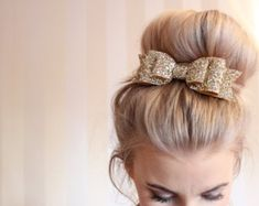 Oversized gold glitter fabric bow hair clip - found on Etsy - perfect hairstyle for a party