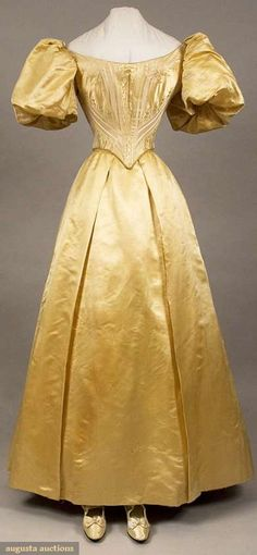 """Ballgown ensemble, American, c1890; Bodice, skirt, shoes and hose of silk buttercup yellow, front lacing bodice, center front and center back waist points, floral and striped silk brocade with satin short balloon sleeves, petersham stamped """"Maison Truffert San Francisco"""", trained satin skirt, matching satin pumps with bow and ankle strap, yellow silk hose, B 32"""", W 21"""", Skirt L 41""""-47"""""""