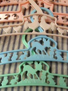 Vintage plastic baby hangers.