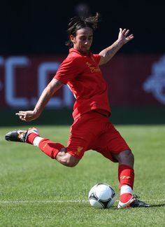 Alberto Aquilani Photos - Alberto Aquilani #18 of Liverpool plays the ball against Toronto FC during the World Football Challenge friendly match on July 21, 2012 at Rogers Centre in Toronto, Ontario, Canada. - Liverpool v Toronto FC