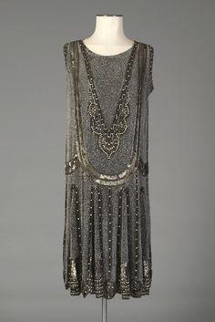 Black chiffon sleeveless dress with allover beaded design, English, mid-1920s, KSUM 1996.58.405.