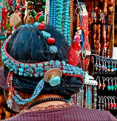 Tibet | Tibetan Women wearing/selling traditional Turquoise Jewelry. Lhasa, | ©Nora de Angelli