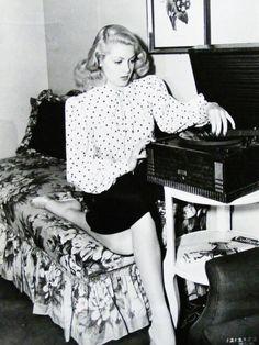 Lana Tuner listening to records