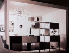 The light fixture design has been credited to Eames Office employee Don Albinson