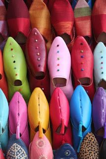 Colorful shoes alignment in a market in Marrakesh. Stock photo by Gautier.