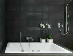 this is nice. love a dark bathroom. big round mirror above would look fab!