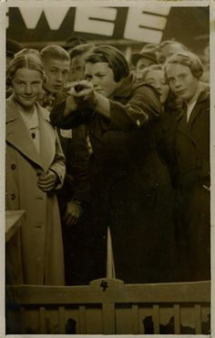 A chronological series of photos, beginning in 1936, when a 16-year-old girl from Tilburg in Holland picks up a gun and shoots at the target in a shooting gallery. Every time she hits the target, it triggers the shutter of a camera and a portrait of the girl in firing pose is taken and given as a prize. At the age of 88, Ria van Dijk was still making her pilgrimage to the Shooting Gallery.