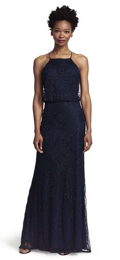 41427f27c999e An elegant full-length beaded gown pairs a halter blouson bodice with a  gently flared