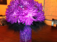 """Off the DIS :)    """"For One Centerpiece You Need:    1 - 2"""" or 1"""" Styrofoam Ball (Depending on the how big your want your arrangement)    2 - 3 Bunches of your Favorite Flower or a Mixture of Flowers from Hobby Lobby or another craft store (When I say bunches I mean each bunch has about 12 or more flowers)    1 Package of Emblishments for bouquets (I used purple flower rhinestones from Michael's you can find them in the bridal aisle)    1 Hot Glue Gun (Low or High Heat)    Glue sticks    Wire…"""