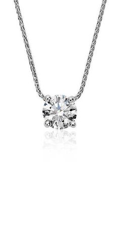 0.60 carat brilliant Blue Nile Signature Ideal Cut round diamond set in a contemporary floating bail design with a luxurious adjustable length chain.