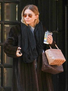 Star Tracks: Thursday, March 26, 2015 | AT THE READY | In a warm fur coat and with coffee and bags in hand, Ashley Olsen dons the typical Olsen uniform for a Tuesday outing in New York City's East Village.