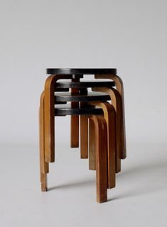 Alvar Aalto (Finland 1898-1976)    Rare x4 Model 60 stacking stools. 1930s. Finmar.    Finmar labels to the underside on three of the stools (the other shows evidence of where the label once was).    Four great original examples of Aaltos model 60 stools – Each has a great colour and shows patina of wear and tear as would be expected and hoped for. The Finmar labels are recognised evidence of them being early edition genuine 1930s stools.
