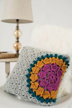 Modern crochet mandala pillow pattern. Spruce up your home decor with this corner to corner crochet pillow.