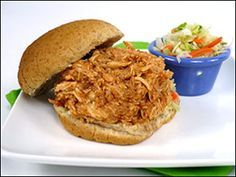 Light Slow-Cookin' Pulled Chicken in the Crock Pot! This recipe is delicious and great to make for lunches throughout the week.