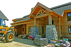We've Broken Down the Entire Construction Process for a Modest Log Home!
