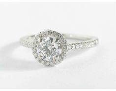 This engagement ring showcases a thin line of micropavé-set diamonds that encircle your center diamond.