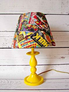 Comic Book Lamp  This link also has other DIY options if you scroll up and down(geeky/nerdy DIY)