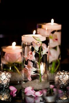 Centerpiece Arrangements of Floating Votives and Pink Flowers in Glass Cylinders, submerged orchids, Asya Photography