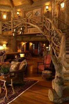 I love the staircase, flooring and lighting in this picture. However, I would have a lighter color of walls since this is too much dark woods.