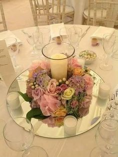 wedding table Corlea, something like this, round mirror replace with square piece.A big candle in middle and small candles surrounding. I like this arrangement. Wedding Table Centres, Wedding Table Centerpieces, Wedding Decorations, Table Wedding, Wedding Mirror, Wedding Stage, Wedding Table Arrangements, Wedding Mandap, Stage Decorations