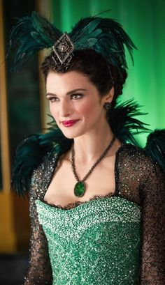 Look at her costume! Green and Emerald dress with jewels, and feathers. She's Evanora in Oz: The great and powerful.