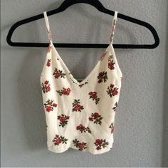 Brandy Melville floral rose tank size small, but could fit medium. only worn twice. Brandy Melville Tops Tank Tops