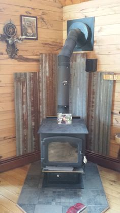 Wood Stove Floor Heat Shield inside Metal Barn Roof Tin Woodstove Heat Shield Our Little Cabin Wood Stove Wall, Corner Wood Stove, Wood Stove Surround, Wood Stove Hearth, Stove Fireplace, Wood Burner, Wall Wood, Wood Stove Heat Shield, Corrugated Tin