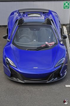 The gorgeous 650S spider in Aurora blue. Shot by Supercar Driver at McLaren Manchester