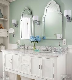 Mirror, Mirror Round, oval, and even scalloped -- mirrors come in a variety of shapes, so you don't have to settle for a boring rectangle. Here, Venetian-style mirrors add elegance to a cottage-style bathroom.