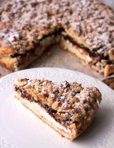 Classique de la pâtisserie italienne, le Gâteau miettes au Nutella et à la ricotta (Sbricciolata ricotta e Nutella) est un dessert gourmand préparé avec la