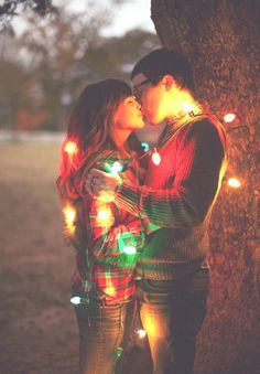 String yourself + your fiance in Christmas lights to create a festive + playful winter engagement photo.