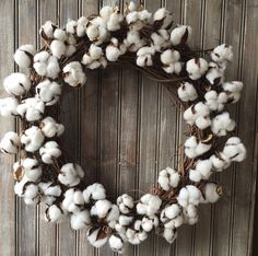 23 grapevine wreath adorned with cotton bolls as shown. Simple country style that is timeless...