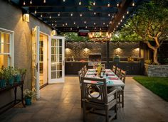 Pick Your Shade: Trendy Covered Patios and Decks that Take Fall Party Outdoors Gorgeous Edison bulbs illuminate the lovely covered patio with outdoor kitchen and dining Backyard Patio Designs, Pergola Designs, Patio Ideas, Pergola Ideas, Pergola Kits, Backyard Covered Patios, Covered Patio Design, Covered Back Patio, Covered Decks