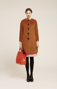 OK, I'm dying over this coat from----> Orla Kiely lookbook for Autumn Winter 14