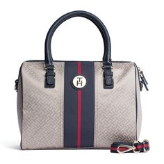 The Merrit Duffle is made from a blend of cotton and polyester with leather handles and trim.  Adjustable and detachable leather strap. Grosgrain stripe in signature Tommy Hilfiger colours at the front, metal TH badge.  Main compartment zips closed. Inside is lined and has zippered pocket and key finder.