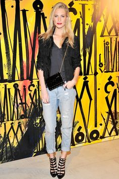 Poppy Delevingne.. Jimmy Choo accessories – heels and bag – with jeans and fringed jacket. (April 2014)