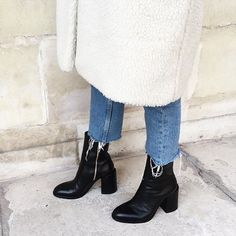 white wool coat + raw hem boyfriend jeans + black ankle boots