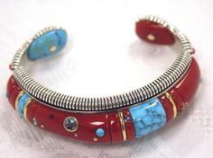 Cuff | Raymond C. Yazzie. Sterling silver, gold, coral, turquoise.
