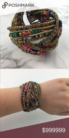 🌟Coming Soon!🌟 Multicolored Beaded Bracelet 🌟Coming Soon!🌟 Multicolored beaded cuff style bracelet. Separate grouped strands are woven to produce this cuff with gold and bright colored beads. Goes with many outfits! Jewelry Bracelets