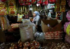 A vendor waits for customers at her spice stall at Senen market in Jakarta, Indonesia.