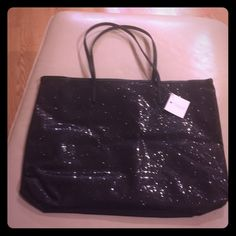 """NWT SALE Black Macys tote bag glitter sparkle new NWT Macys brand black tote back with black glitter! Nylon material; super easy to wipe clean. approx 4"""" wide, 11"""" height, 17"""" long. handles are approx 8"""" ! Sale won't last! very cute and trendy  Macy's Bags Totes"""