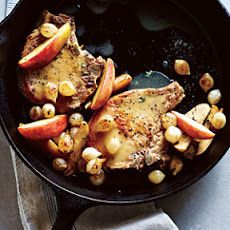 Pork Chops with Roasted Apples and Onions Recipe Main Dishes with canola oil, pearl onions, gala apples, butter, fresh thyme leaves, kosher salt, ground black pepper, center cut pork loin chops, lower sodium chicken broth, all-purpose flour, cider vinegar