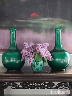 Lilacs. Atop a Chinese altar table, Qing vases flank an earthenware jar acquired by the husband's father at a jumble sale 75 years ago.